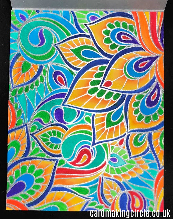 A colourful card created with with Color Me Background from Taylored Expressions.  coloured with Zig clean color markers.