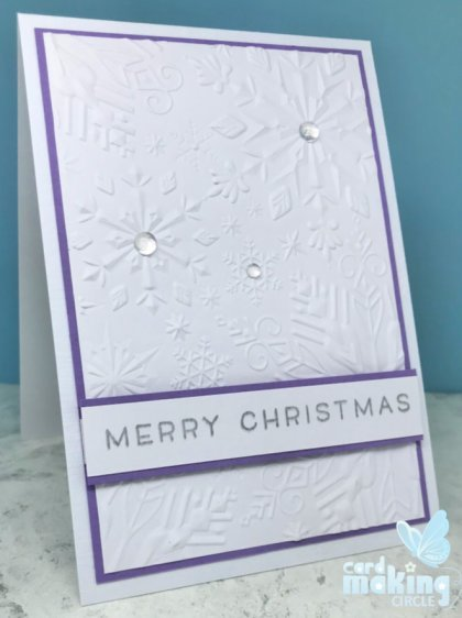 Easy Christmas card made with a snowflake embossing folder from Sizzix