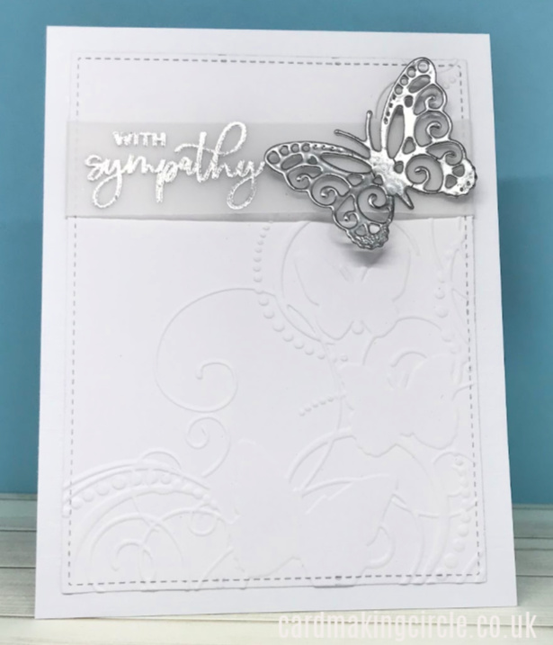 Beautiful sympathy card created with a Darice embossing folder and topped with a heat embossed sentiment and die cut butterfly.