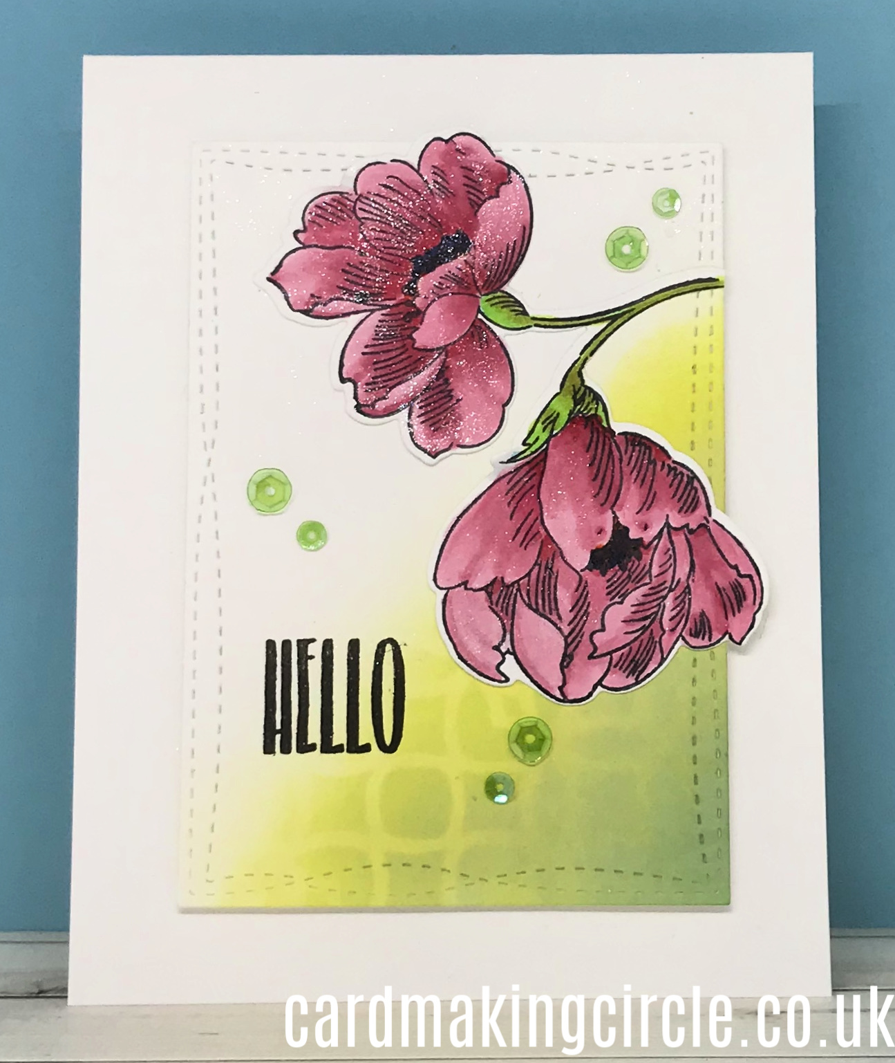 A handmade greeting Card made with Altenew's Pen Sketched Flowers stamp set.  Coloured with Copic markers