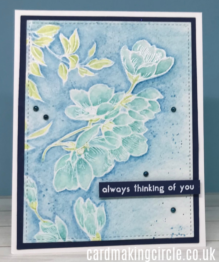 The card uses the Pen Sketched Flowers Stamp set from Altenew.  The images were heat embossed in white embossing powder and painted using the Altenew paint set.