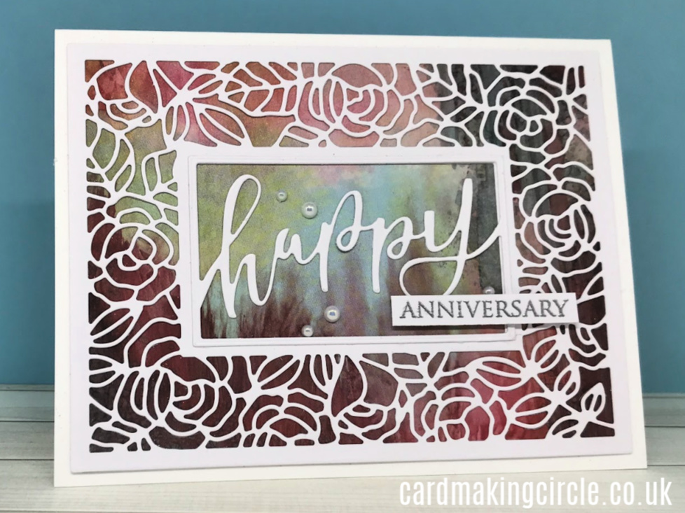 A striking wedding anniversary card create from the Framed Roses cutting plate and Happy Framed Script die from Taylored expressions.  Background card from Clarity Stamps.
