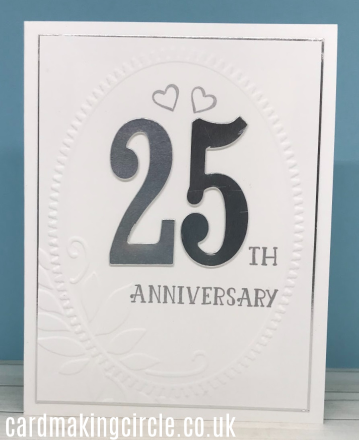 A clean and simple 25th wedding anniversary card created with an embossing folder from Sizzix.