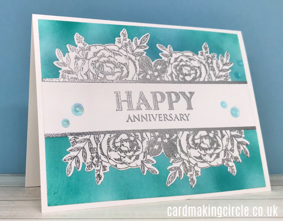 A clean and simple wedding anniversary card made using the Flip the Floral stamp set and die from Taylored Expressions.