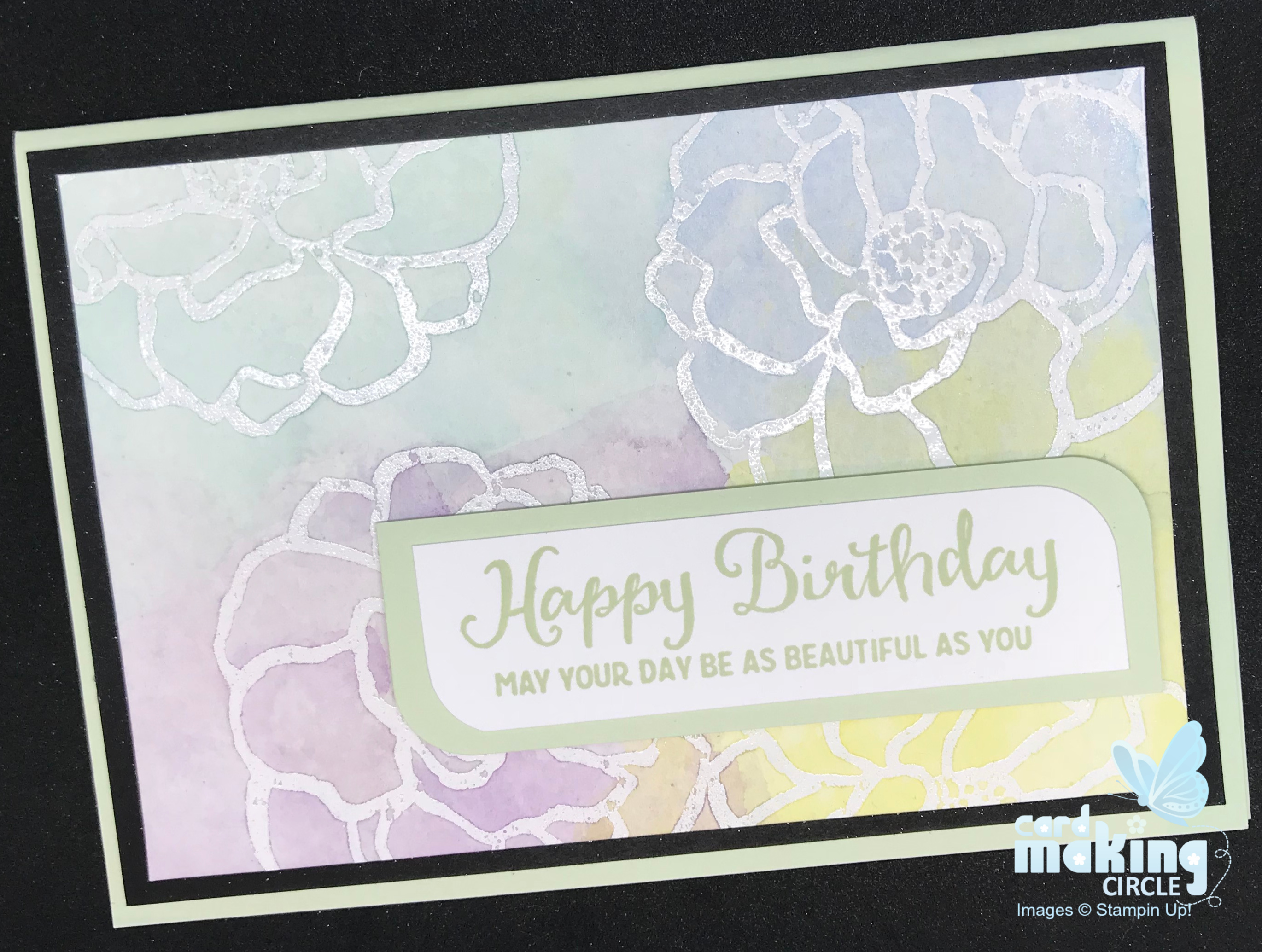 flower birthday card made with watercolouring and heat embossed images.