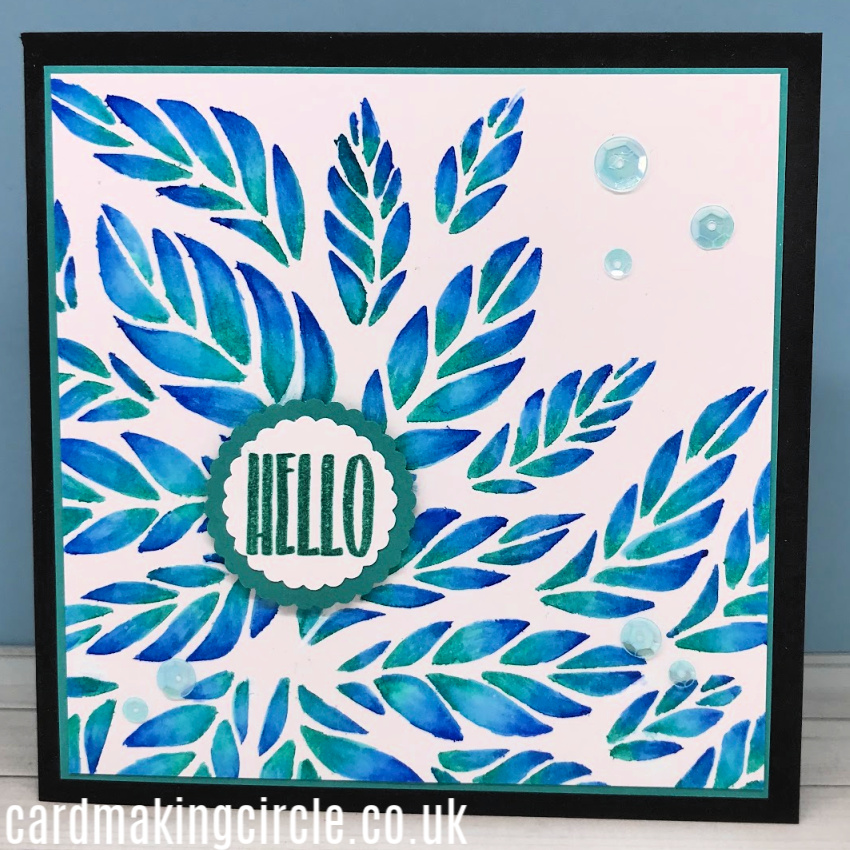 A Hello card created with the Tumbling Leaves stencil from Simon Says Stamp.  My first card for the 30 Day Coloring Challenge.
