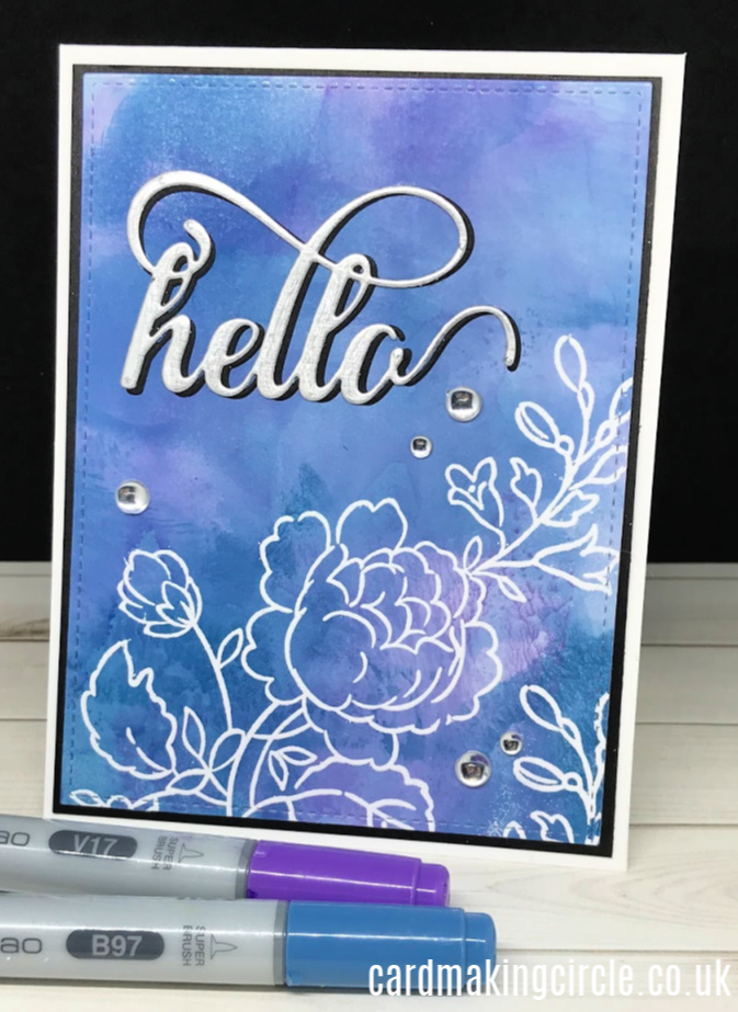 Hello card made using the ink smooshing technique with alcohol markers.  Heat embossed with the Handpicked Bouquet stamp set from Altenew.