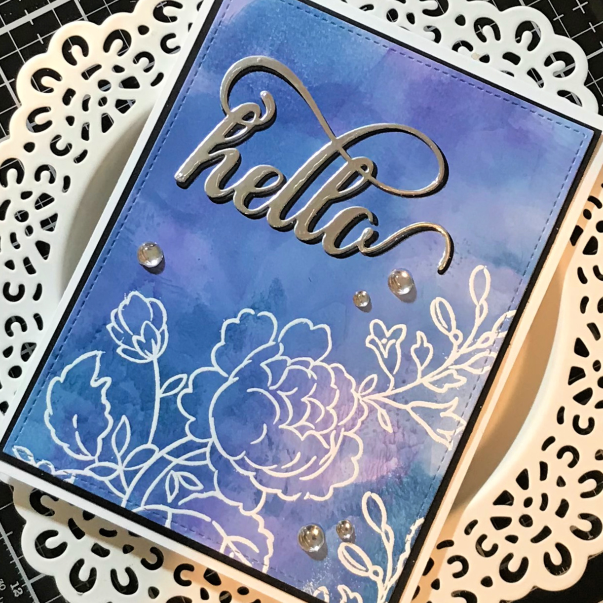 Hello card made using the ink smooshing technique with alcohol inks.  Heat embossed with the Handpicked Bouquet stamp set from Altenew.