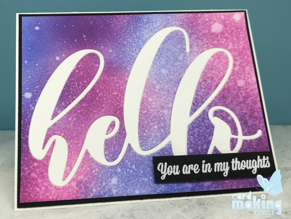Inlaid die cutting made with the large Hello die from Altenew