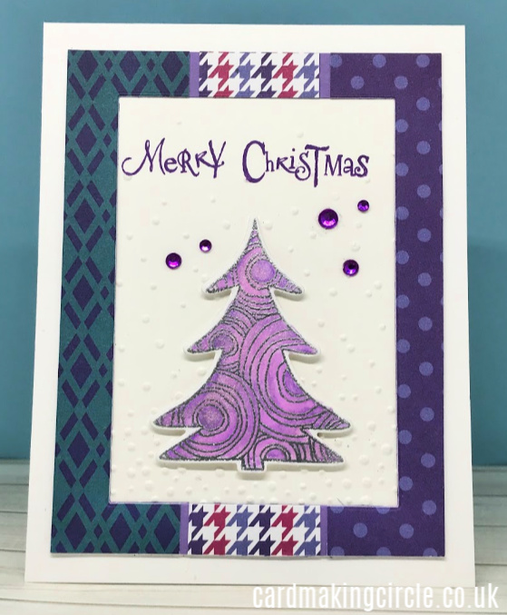 Modern Christmas card made with patterned patter from Reverse Confetti.  Christmas tree stamp and die from Simon Says Stamp.  Sentiment from Clarity Stamps.