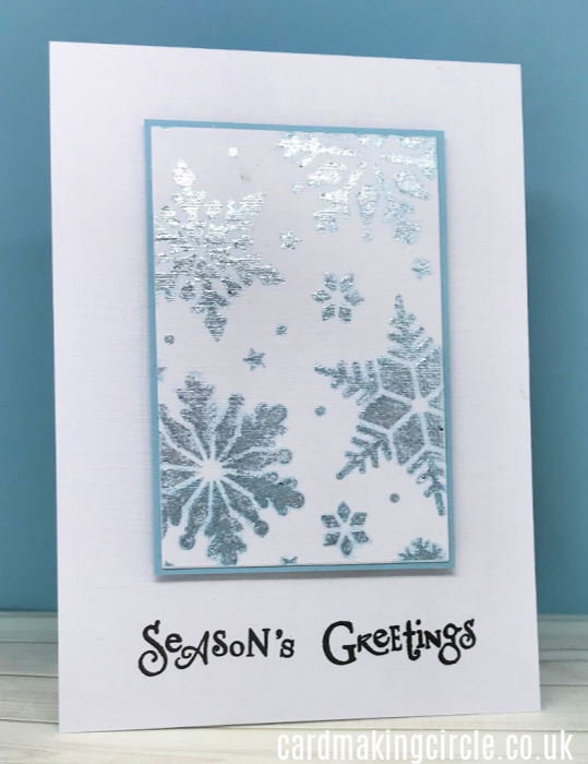 modern Christmas card made with the snowflake stencil from Tonic and Glacier Glimmer paste.  Sentiment from Clarity stamps