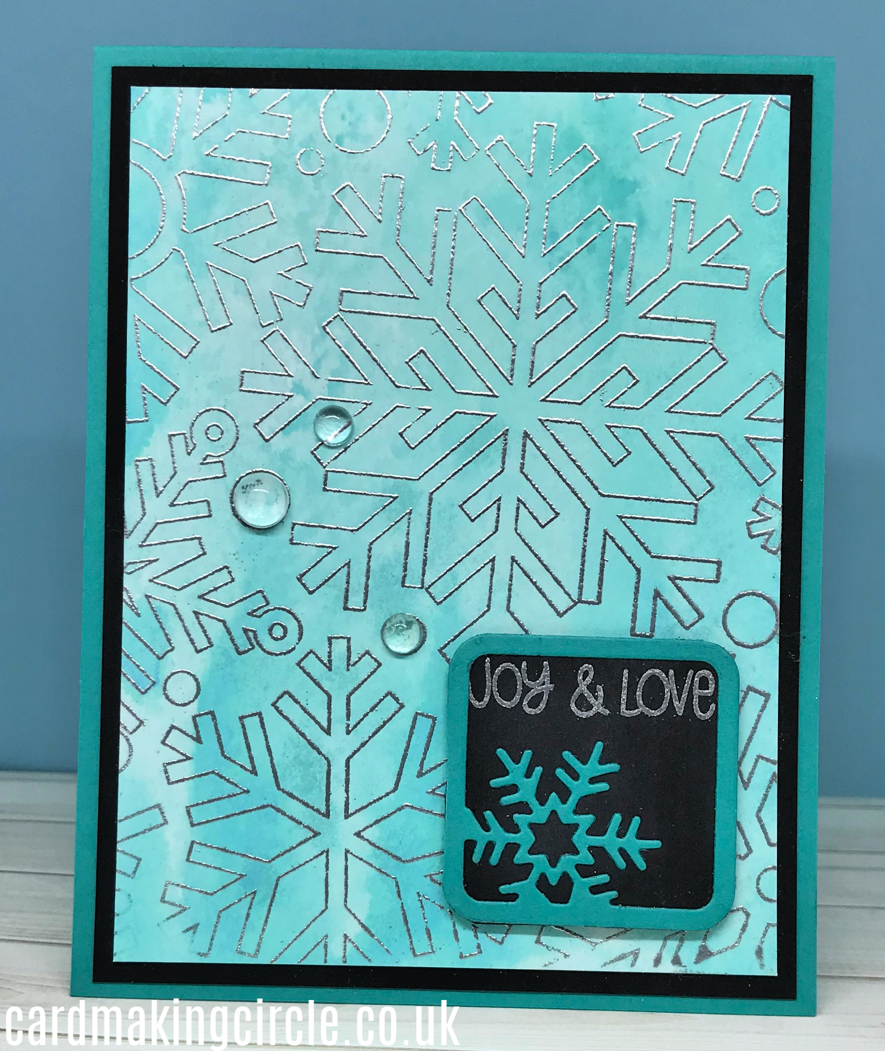 Snowflake card made with the ink smooshing technique.  Used the Outline Snowflake background stamp from Simon Says Stamp.