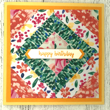 Patchwork card made with scraps of patterned paper