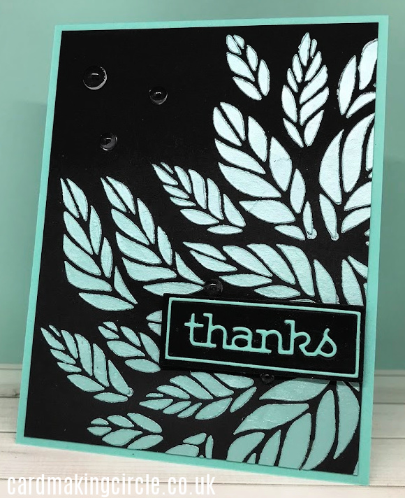 A Thanks card created with the Tumbling Leaves stencil from Simon Says Stamp.  Background created with Nuvo embellishment mousse.