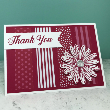 Blocks of patterned paper used to create background to card