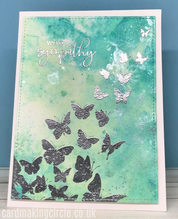 A colourful sympathy card created by using the ink smooshing technique with distress inks.  The images are from the A Flutter stamp set from Taylored Expressions.