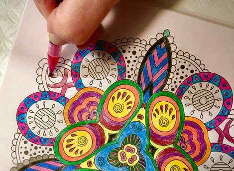 colouring mandala with coloured pencils